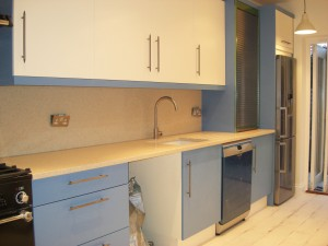 Blue & Ivory Slab Door Kitchen, Stainless Steel Accents, Tambour Door, Deep Pan Drawers. Copyright Celtica Kitchens 2015
