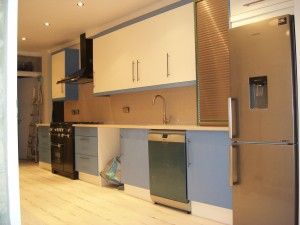 Blue & Ivory Slab Door Kitchen, Stainless Steel Accents, Tambour Door. Copyright Celtica Kitchens 2015