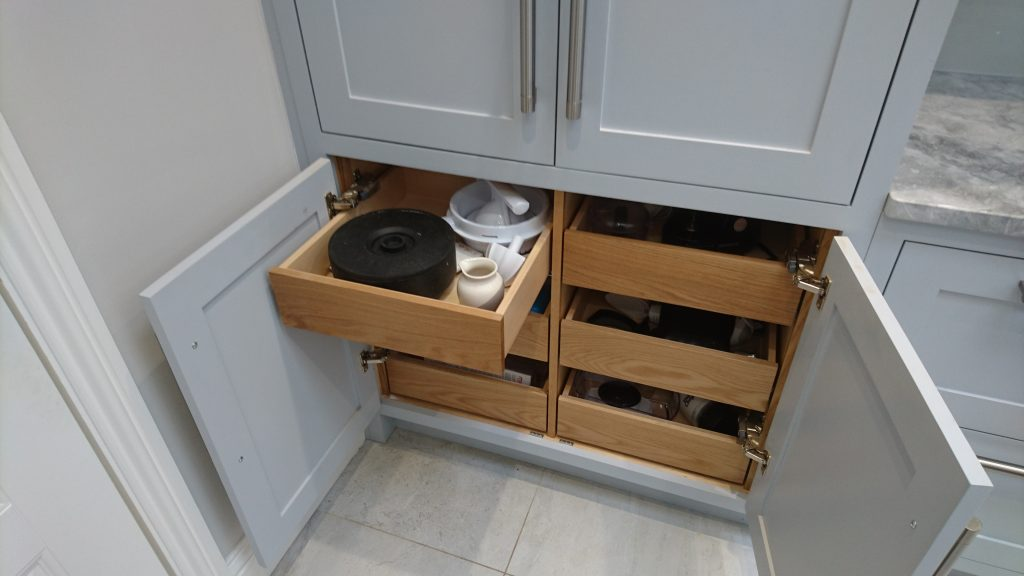 Internal drawers in large pantry cupboard by Celtica Kitchens with beech drawerboxes, lacquered oak internal drawerfronts